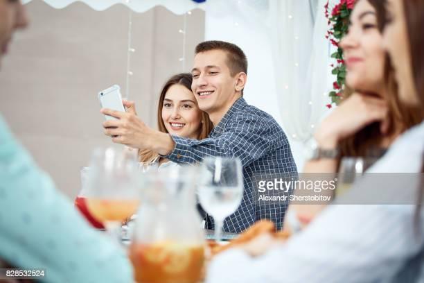 Cheerful couple taking selfie