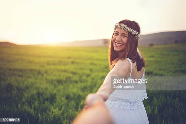 cheerful couple walking through field - karl lagerfield bildbanksfoton och bilder