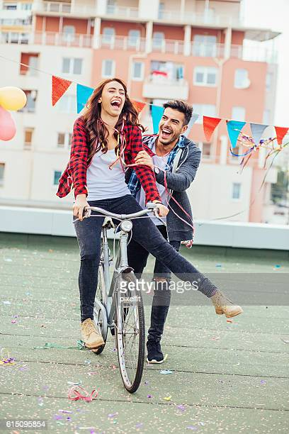 Cheerful couple with a bicycle