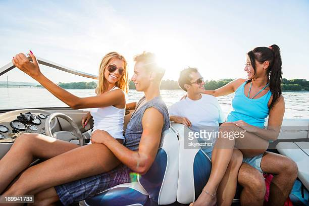 Cheerful couples on a speedboat.