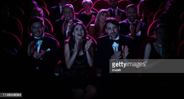 cheerful crowd applauding while watching opera - opera stock pictures, royalty-free photos & images