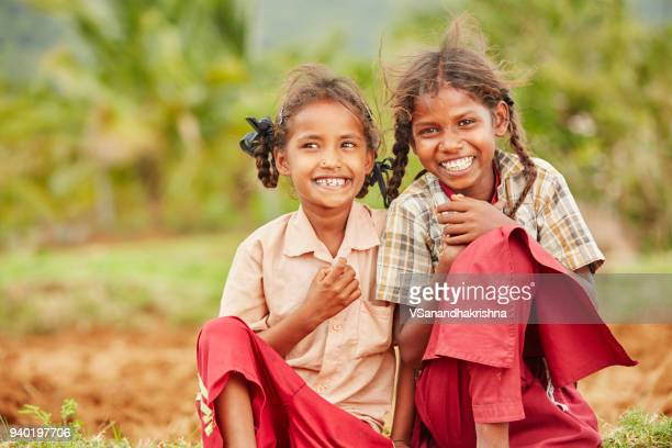cheerful cute indian sisters in school uniform - tamil nadu stock pictures, royalty-free photos & images