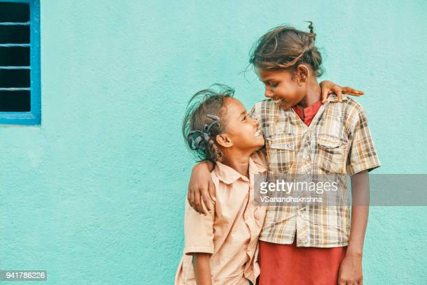 cheerful cute indian sisters - hinduism stock pictures, royalty-free photos & images