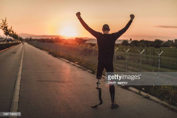 cheerful disability man athlete - fake man stock photos and pictures