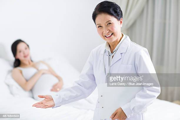 Cheerful doctor and pregnant woman