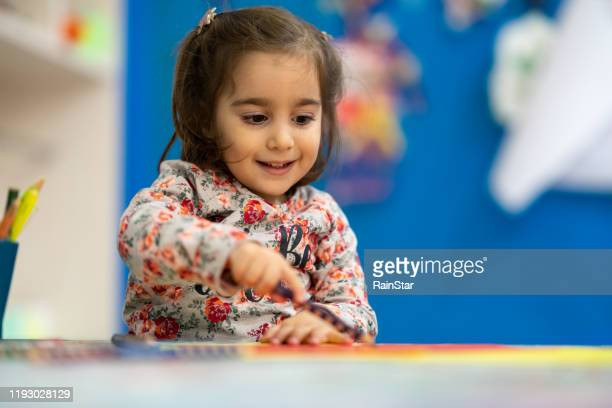 cheerful drawing - montessori education stock pictures, royalty-free photos & images