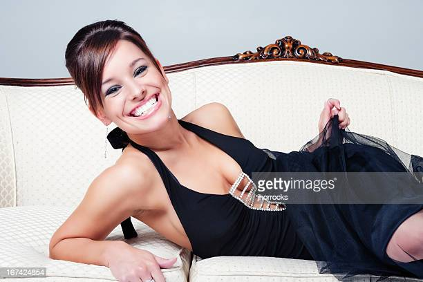 Cheerful Elegant Young Woman Posing on Antique Sofa