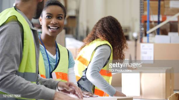 Cheerful employees working in distribution warehouse