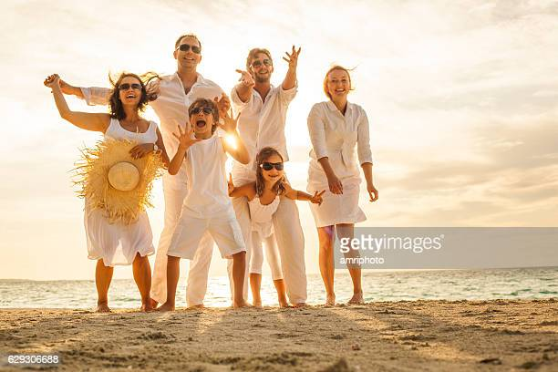 cheerful family beach sunny afternoon - family beach holiday stock pictures, royalty-free photos & images