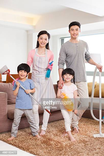 cheerful family doing chores at home - kids with cleaning rubber gloves stock pictures, royalty-free photos & images