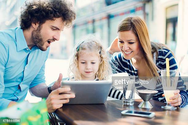 Cheerful family enjoy quality time in cafe.