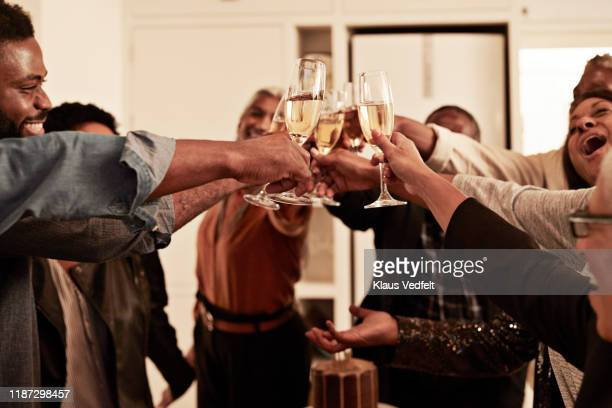 cheerful family enjoying drinks at birthday party - honour stock pictures, royalty-free photos & images