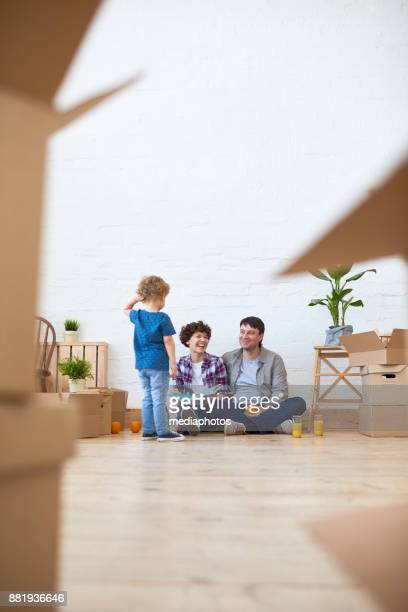 Cheerful family enjoying new life in new house
