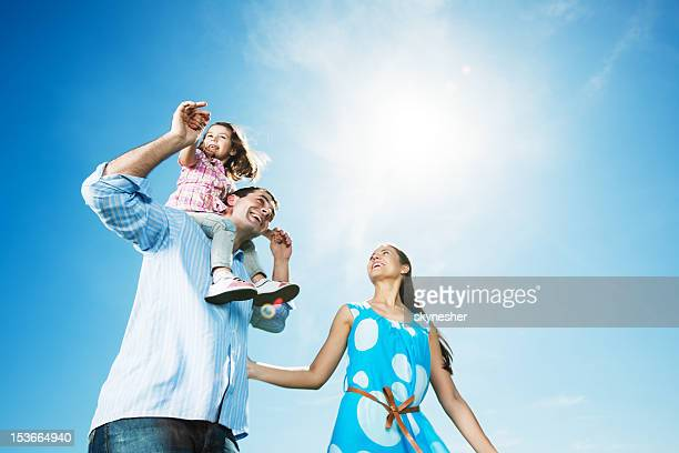 Cheerful family enjoying together outside.