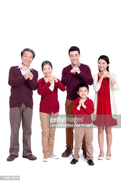 Cheerful family greeting for Chinese New Year