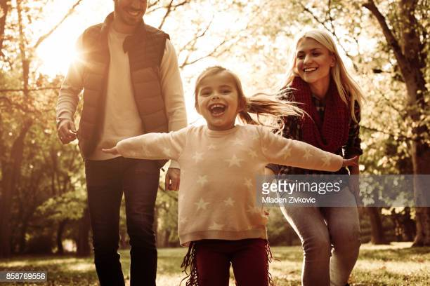 Cheerful family in park.