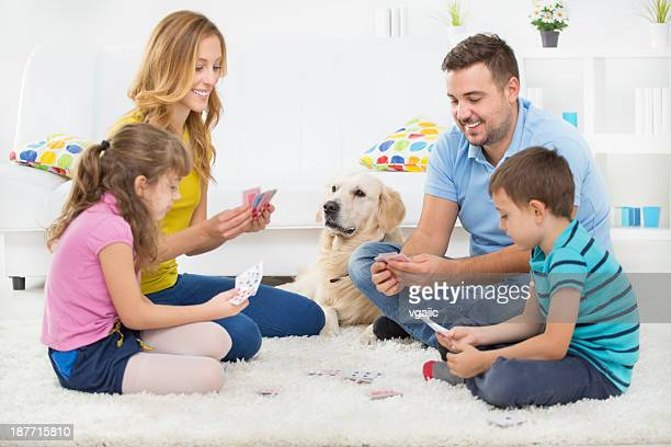 Cheerful Family Playing Cards.