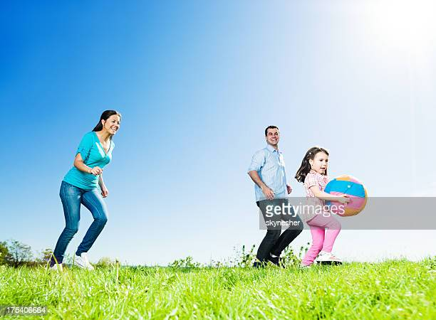 Cheerful family playing in the park.