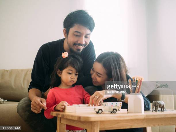 cheerful family playing wood toy. - game night leisure activity stock pictures, royalty-free photos & images