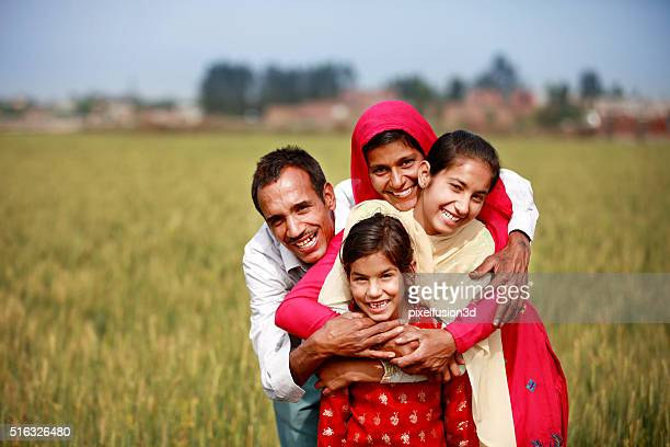 cheerful family portrait - indian stock pictures, royalty-free photos & images