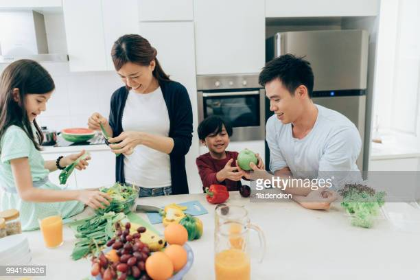 Cheerful family preparing lunch together