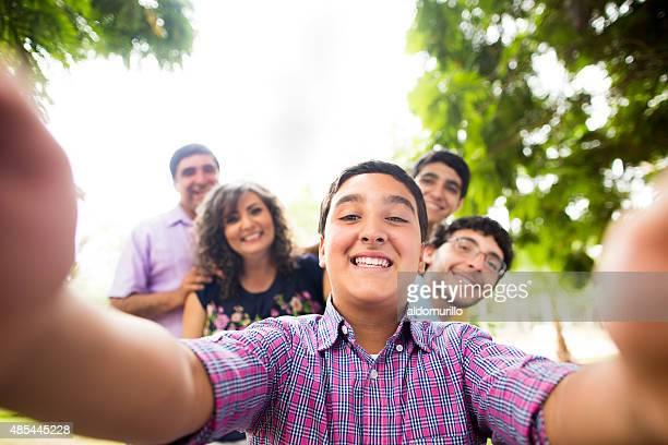 Cheerful family taking selfie
