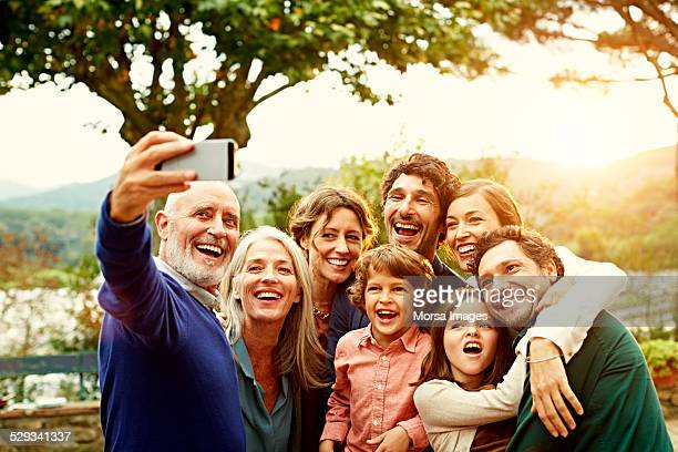 Cheerful family taking selfie