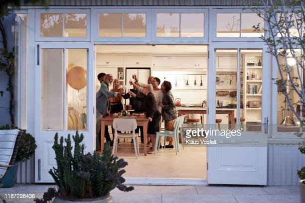 cheerful family toasting drinks during birthday party - casa foto e immagini stock