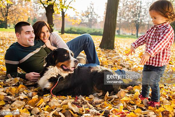 Cheerful family with dog outdoor