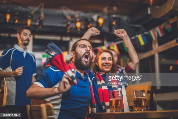 cheerful fans - international soccer event stock pictures, royalty-free photos & images