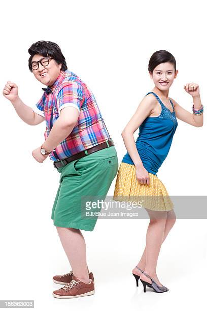 Cheerful fat man with girlfriend dancing