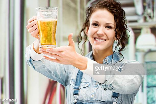 Cheerful female brewmaster at a brewery