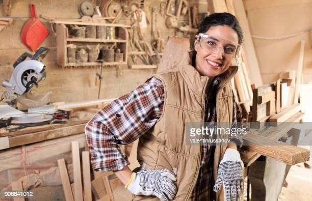 Cheerful female carpenter