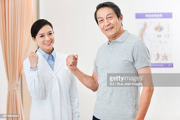 Cheerful female doctor and senior patient