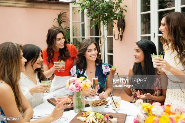 cheerful female friends enjoying lunch at outdoor restaurant - the brunch stock pictures, royalty-free photos & images