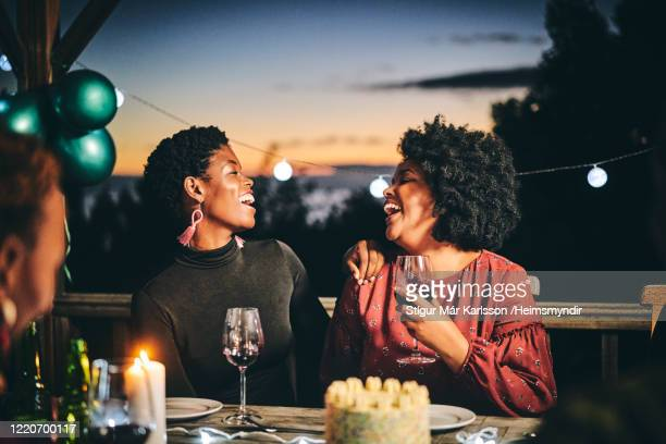 cheerful female friends enjoying wine at birthday - africa stock pictures, royalty-free photos & images