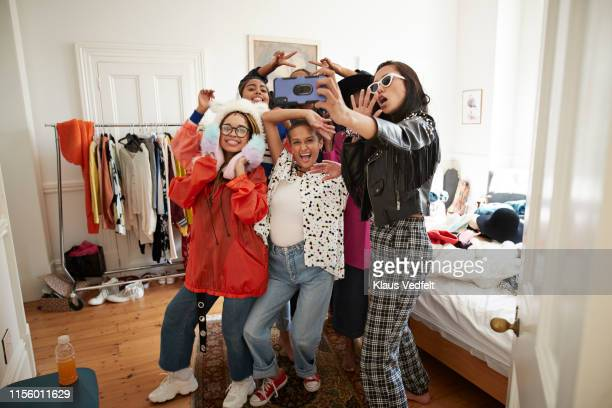 cheerful female friends gesturing while taking selfie - generation z stock pictures, royalty-free photos & images