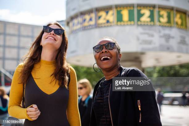 cheerful female friends in city during vacation - berlin stock pictures, royalty-free photos & images