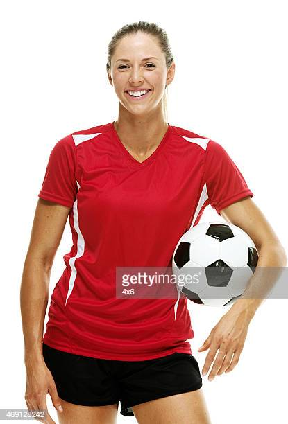 cheerful female soccer player holding ball - football strip stock pictures, royalty-free photos & images