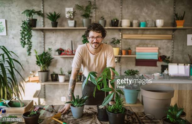 cheerful florist man - botanist stock pictures, royalty-free photos & images