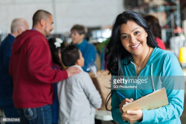cheerful food drive manager - humanitarian aid stock pictures, royalty-free photos & images