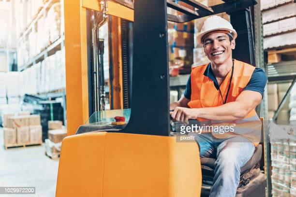 cheerful forklift driver - forklift stock pictures, royalty-free photos & images