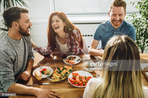 cheerful friends communicating while enjoying in a meal at dining table. - the brunch stock pictures, royalty-free photos & images