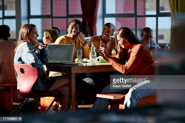 cheerful friends enjoying during lunch break - facebook friends stock pictures, royalty-free photos & images