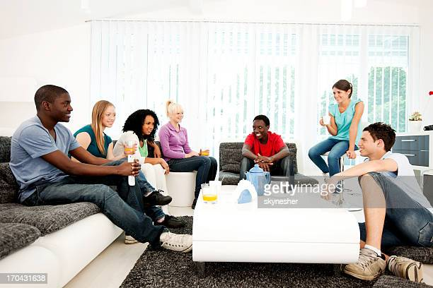 Cheerful friends enjoying in the living room.