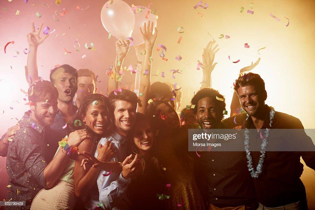 Cheerful friends enjoying on dance floor : Stock Photo