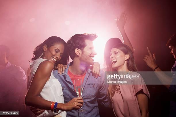 Cheerful friends enjoying on dance floor