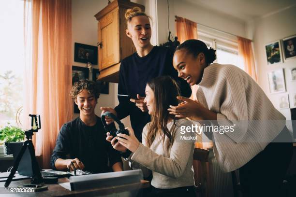 cheerful friends having fun while making music project at home - equaliser stock pictures, royalty-free photos & images