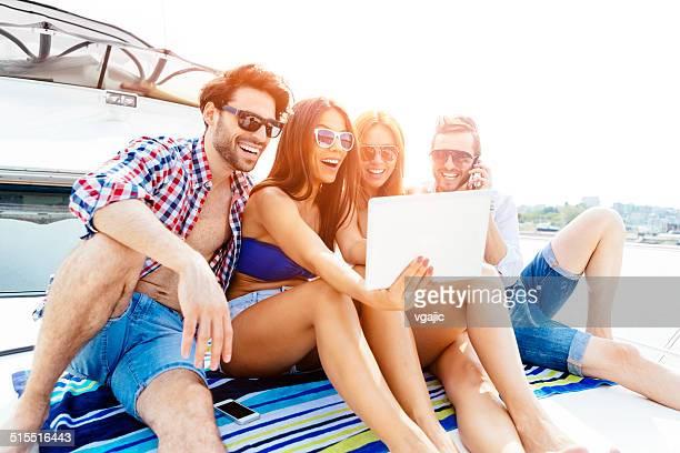 Cheerful Friends Making Selfie On Yacht.