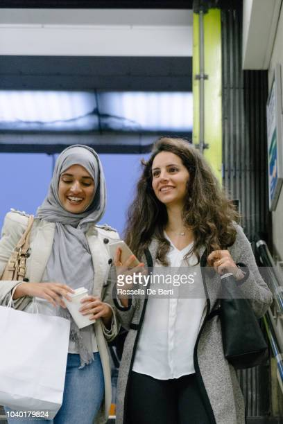 cheerful friends walking in the city - modest clothing stock pictures, royalty-free photos & images